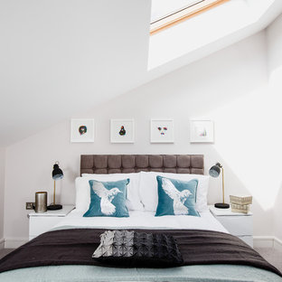 Photo of a traditional mezzanine bedroom in London with white walls and carpet.