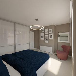 Imagen de dormitorio principal, actual, pequeño, sin chimenea, con paredes grises, moqueta, marco de chimenea de yeso y suelo beige
