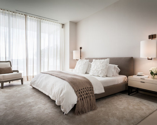 inspiration for a contemporary bedroom remodel in miami with beige walls - Low Rise Bed Frame