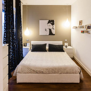 Design ideas for a small contemporary bedroom in Turin with beige walls and dark hardwood flooring.