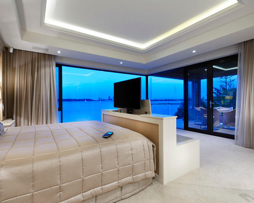 Mid Sized Contemporary Master Carpeted Bedroom Idea In Perth With Beige  Walls