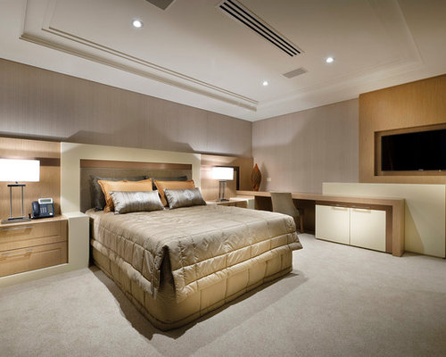 bedroom tv. Trendy master carpeted bedroom photo in Perth with gray walls Lcd Bedroom Tv Wall Mount  Houzz
