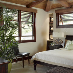 tropical bedroom by Applegate Tran Interiors
