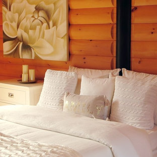 Design ideas for a mid-sized arts and crafts master bedroom in Montreal with light hardwood floors, orange walls and brown floor.