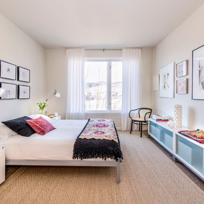 Example of a mid-sized trendy master light wood floor bedroom design in Los Angeles with white walls