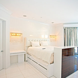 Inspiration for a mid-sized contemporary master bedroom in Los Angeles with white walls, ceramic floors, no fireplace and white floor.
