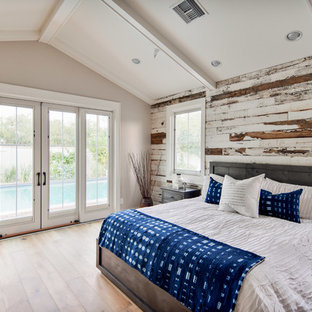 Example Of A Large Mountain Style Master Medium Tone Wood Floor And Brown Bedroom Design