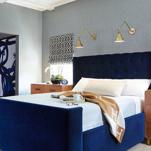 Mid-sized transitional master medium tone wood floor bedroom photo in Dallas with blue walls