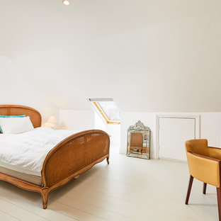 Inspiration for a classic bedroom in London with white walls, painted wood flooring and no fireplace.