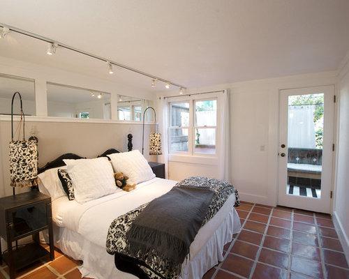 Inspiration for an eclectic terra cotta floor and red floor bedroom remodel  in San Francisco. Bedroom Tile   Houzz