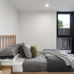 Inspiration for a contemporary guest bedroom in Melbourne with white walls and white floor.