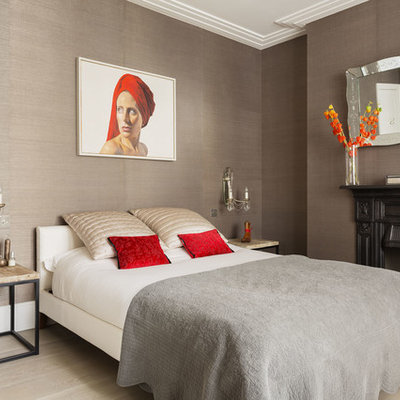 Inspiration for a transitional light wood floor bedroom remodel in London with a standard fireplace and brown walls