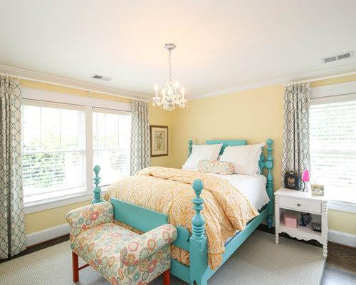 midsized elegant guest bedroom photo in dc metro with yellow walls dark hardwood