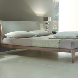 Armobil - Divine Bedroom - Divine bed in walnut, of the Lounge collection, is also available in dark oak, carbone oak, or tabacco oak veneer, glossy, matt or open pore lacquered. The optional headboard cushion can be upholstered in fabric, leather or leather effect material. Combined with Sound bedside tables. - See more at: http://iqmatics.com/webstore/productdetail.aspx?prodid=3075&depid=-1#sthash.zaXhoBoe.dpuf