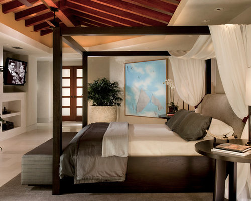 Inspiration for a contemporary bedroom remodel in Orange County with beige walls & Ceiling Mounted Canopy Bed | Houzz