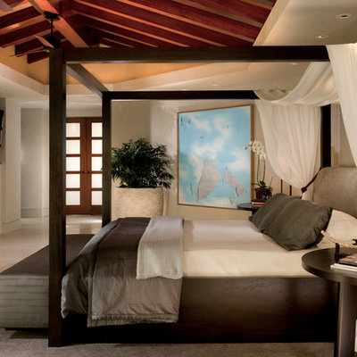 Inspiration for a contemporary bedroom remodel in Orange County with beige walls