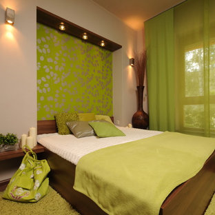 Inspiration for a contemporary bedroom with green walls and green floor.