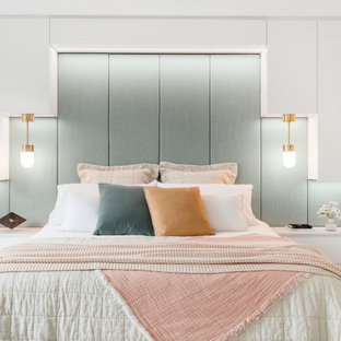 Design ideas for a contemporary bedroom in Brisbane with white walls, light hardwood floors and beige floor.