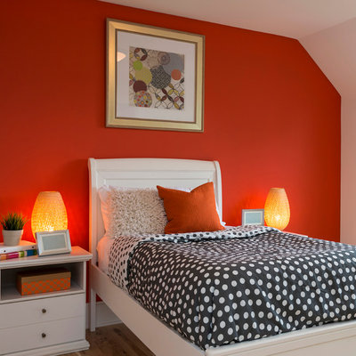 Inspiration for a timeless medium tone wood floor bedroom remodel in Minneapolis with orange walls and no fireplace