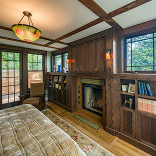 Design ideas for a mid-sized arts and crafts master bedroom in Boston with green walls, light hardwood floors, a standard fireplace and a tile fireplace surround.