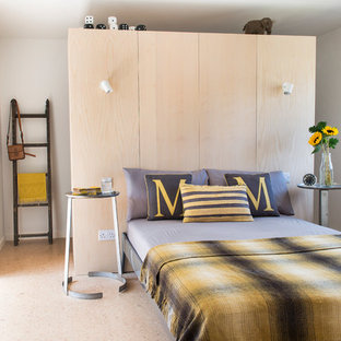 Design ideas for a scandinavian bedroom in Gloucestershire with white walls and beige floors.