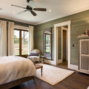 Large arts and crafts master dark wood floor bedroom photo in Other with green walls and no fireplace