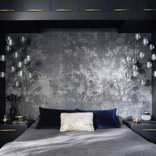 Inspiration for a mid-sized eclectic master bedroom in San Francisco with grey walls, dark hardwood floors and black floor.