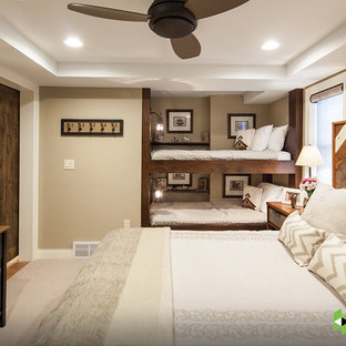 Example of a mountain style guest medium tone wood floor bedroom design in Other with beige walls and no fireplace