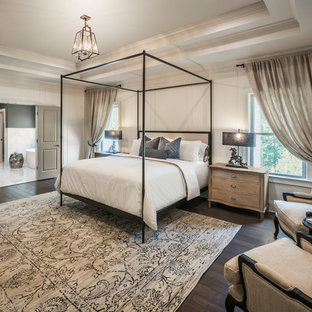 Example of a classic master dark wood floor and brown floor bedroom design in Atlanta with white walls