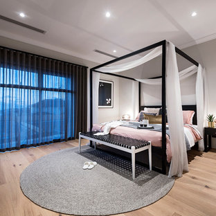 Design ideas for an asian master bedroom in Perth with grey walls, light hardwood floors and beige floor.