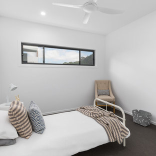 This is an example of a bedroom in Other with white walls, carpet and black floor.