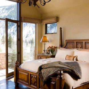 Bedroom - traditional master dark wood floor bedroom idea in Denver with beige walls