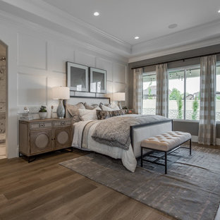 Inspiration for a large timeless master light wood floor and brown floor bedroom remodel in Salt Lake City with gray walls and no fireplace