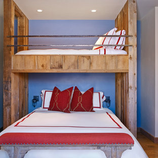 Inspiration for a rustic bedroom remodel in Houston with blue walls