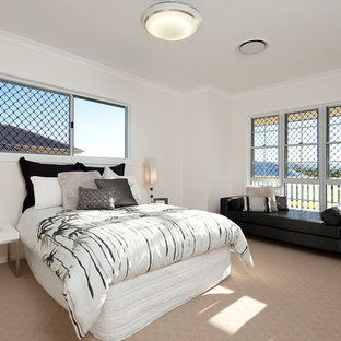 Photo of a classic bedroom in Brisbane with beige walls and carpet.