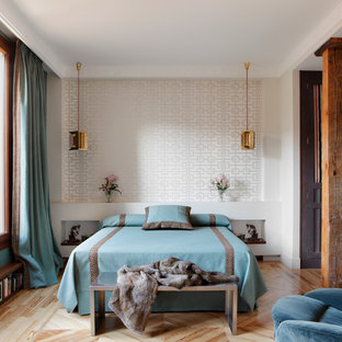 Inspiration for a mid-sized traditional master bedroom in Madrid with white walls, medium hardwood floors and no fireplace.