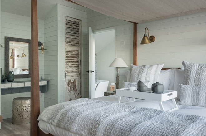 Beach Style Bedroom by Unique Home Stays