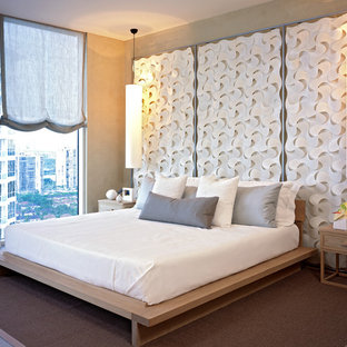 Inspiration for a contemporary master bedroom remodel in Denver with beige walls and no fireplace
