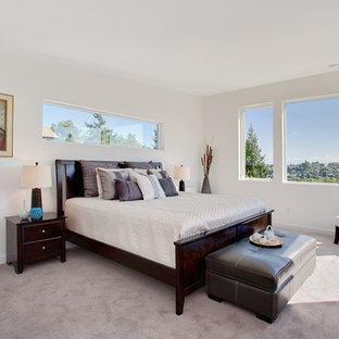 Inspiration for a transitional bedroom in Seattle with white walls and carpet.