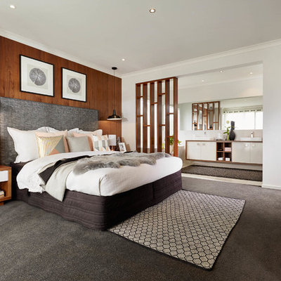 Trendy master carpeted bedroom photo in Melbourne