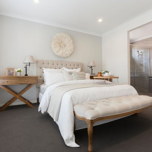 Inspiration for a traditional master bedroom in Melbourne with grey walls, carpet and grey floor.