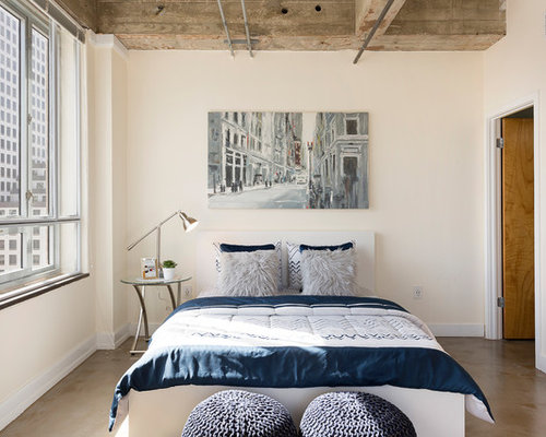 Example Of A Small Urban Concrete Floor Bedroom Design In Austin With Beige  Walls