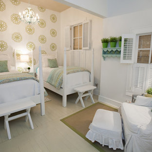 Cottage guest painted wood floor bedroom photo in Austin with white walls and no fireplace