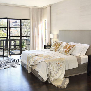 Design ideas for a large contemporary master bedroom in Austin with white walls, dark hardwood floors, no fireplace and brown floor.