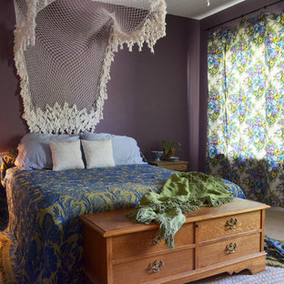 Inspiration for an eclectic bedroom remodel in Austin with purple walls