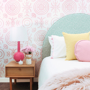 Inspiration for a mid-sized contemporary master bedroom in Sydney with pink walls, carpet and brown floor.