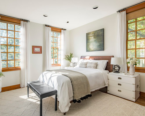 Mid-sized eclectic master medium tone wood floor and brown floor bedroom  photo in Boston