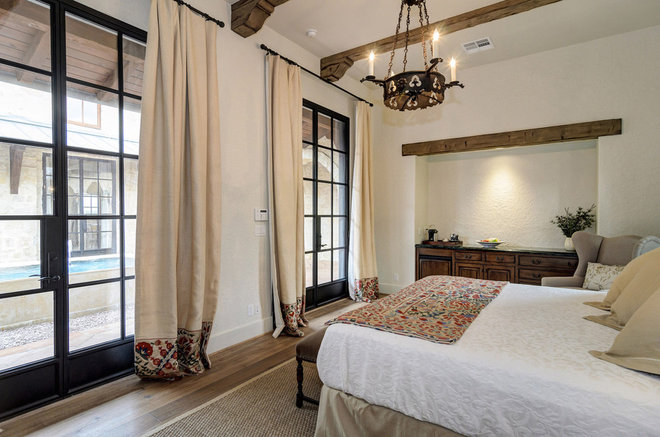 Rustic Bedroom by Design Visions of Austin