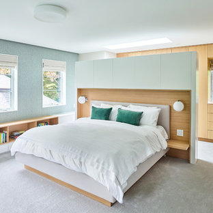 Inspiration for a contemporary master bedroom in Toronto with green walls, carpet, no fireplace and grey floor.
