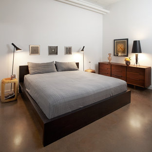 Trendy concrete floor bedroom photo in Toronto with white walls